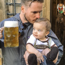 Photographer Dan Brown with son Callan and large stein of beer in West Seattle