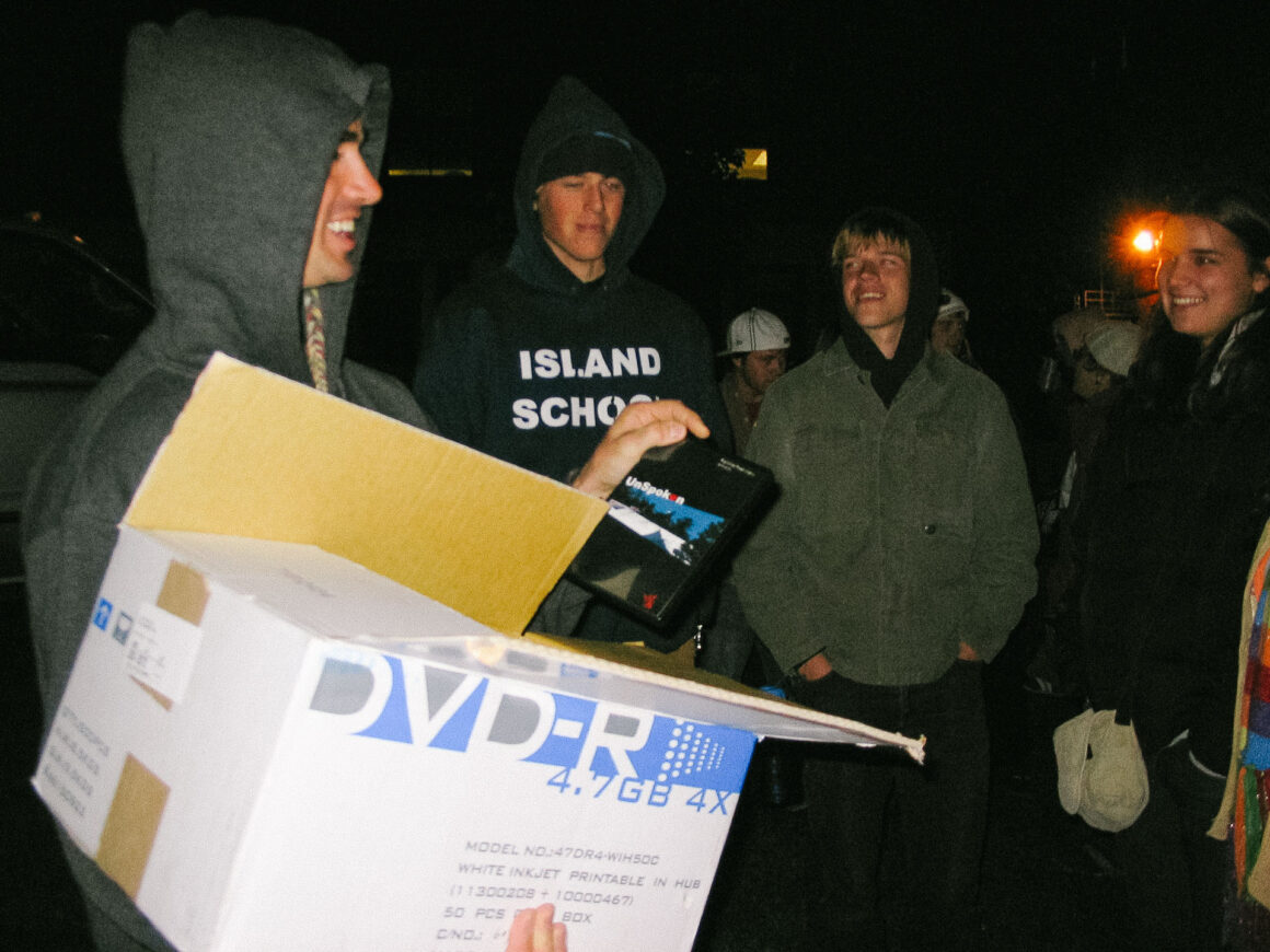 """Jason Levinthal handing out DVDs of Rightside Productions """"UnSpoken."""""""
