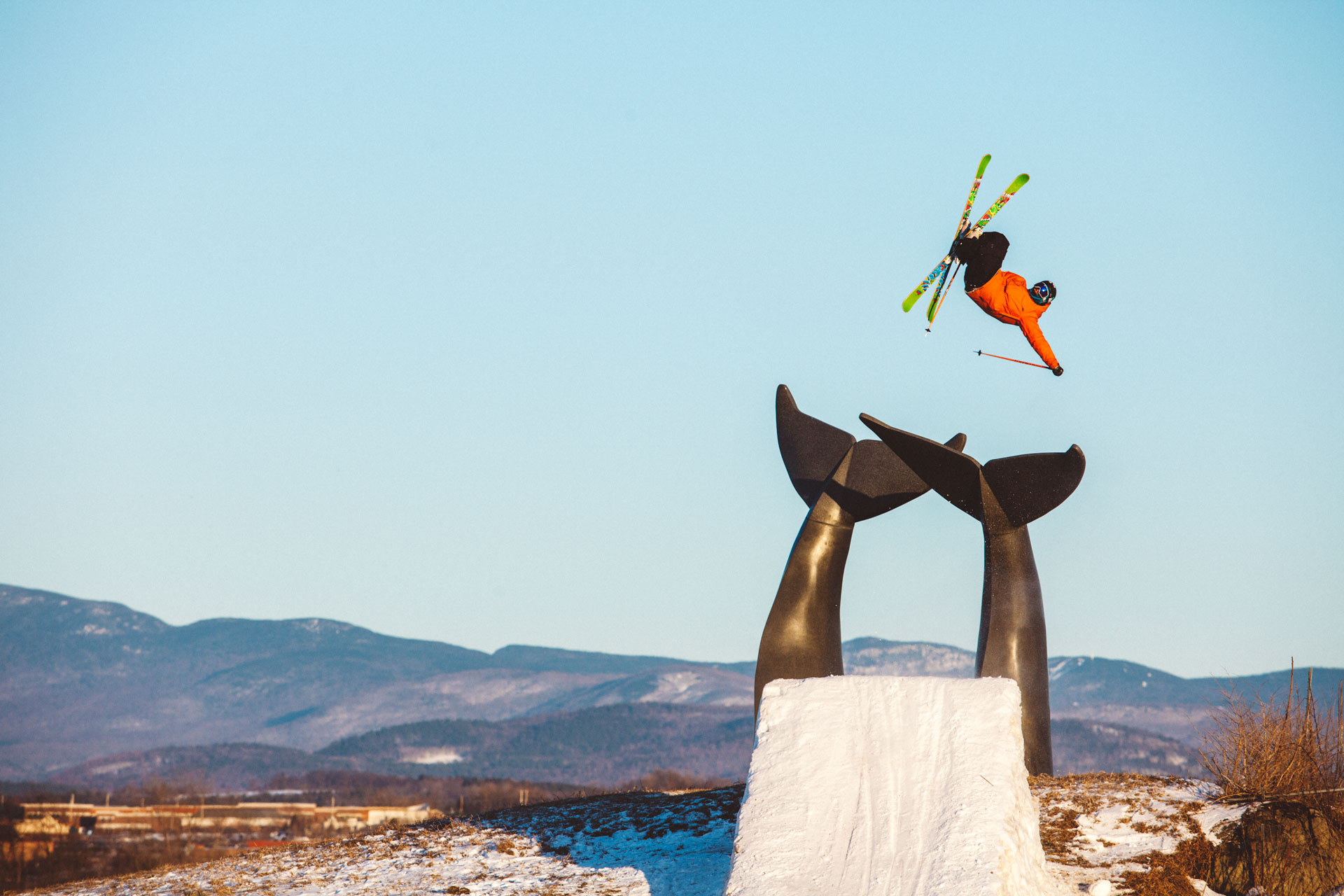 Skier jumps over Whales' Tail Sculpture