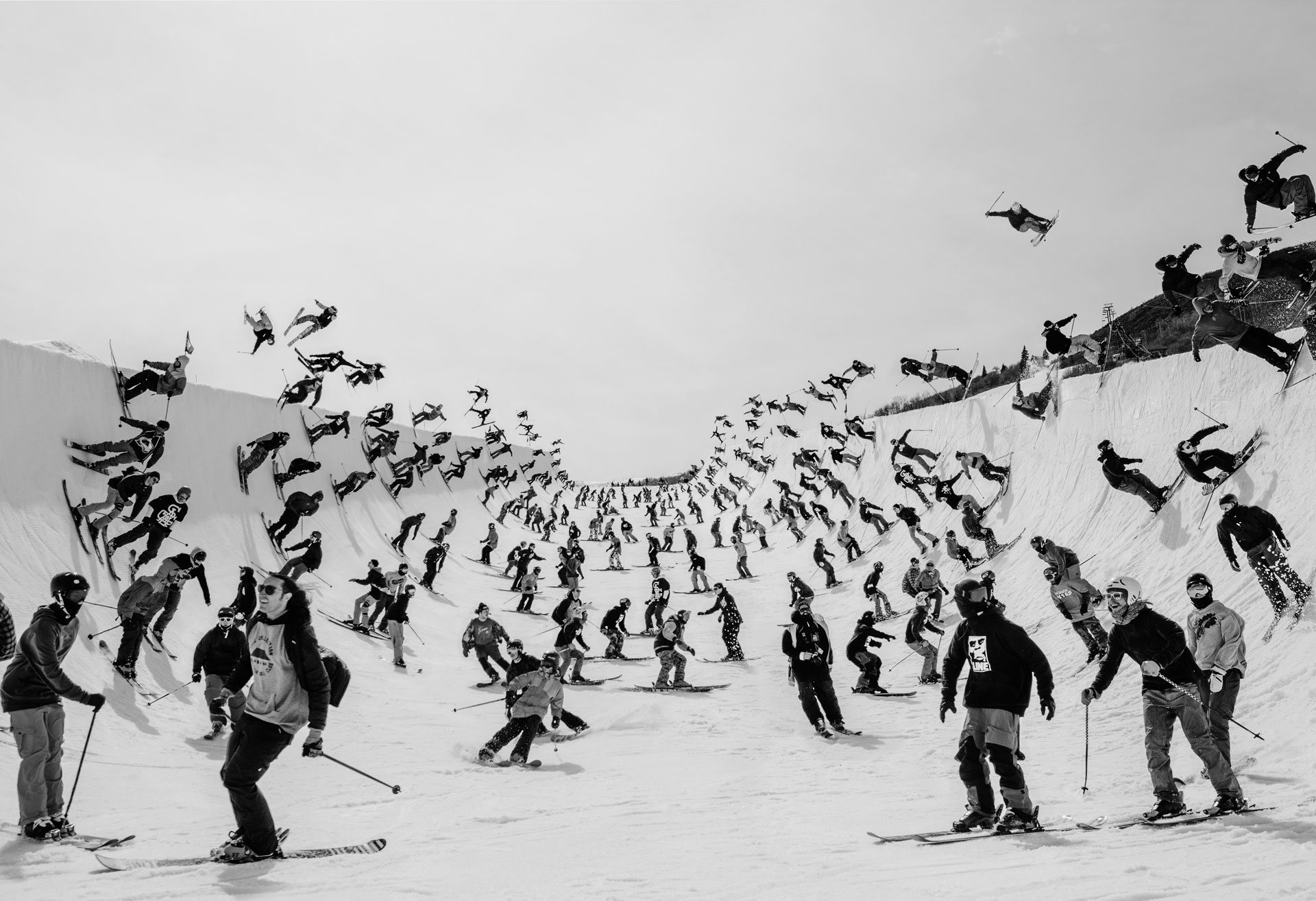 A composite image of a lot of skiers in a superpipe